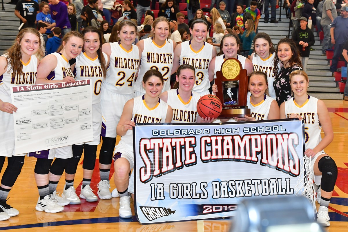 The Kit Carson Lady Wildcat's and their State Championship Trophy that they received Saturday, Mar. 9th in Pueblo. Front row; L-R, Haley Johnson, Olivia Isenbart, McKenzie Smith and Tess Hornung.  Back row: L-R, Faith Johnson, Tieler Randel, Mercede Smith, Cally Booker-Rady, Stephanie Framel, Reyna Isenbart, Jordyn Weeks, Allison Gekeler, Faye Buttry. - Photo Credit Bob Schecter